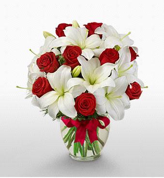 Kayseri çiçek çiçekçiler  1 dal kazablanka 11 adet kırmızı gül vazosu